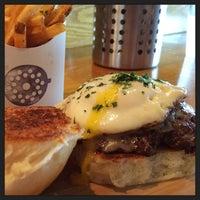 Photo taken at Grind Burger Kitchen by Sam G. on 8/16/2014