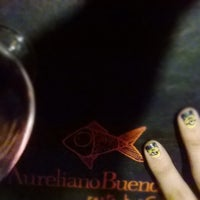 Photo taken at Aureliano Buendia by Cecilia F. on 7/19/2014