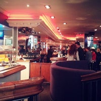 Photo taken at The Chameleon Restaurant & Bar by Andrea B. on 9/27/2013