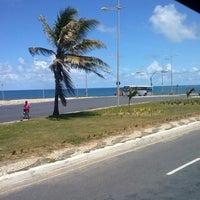Photo taken at Praia Do Costa Azul by Luciana S. on 3/12/2014