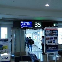 Photo taken at Gate 35 by Issei I. on 12/4/2014
