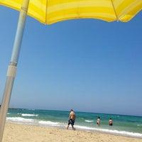 Photo taken at Spiaggia Rodos by Nicolas B. on 7/9/2013