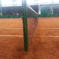 Photo taken at Canoas Tênis Center by Ricardo A. on 8/6/2014