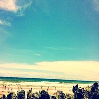 Photo taken at Praia de Ipitanga by Fernando C. on 1/16/2013