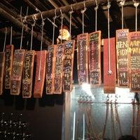 Photo taken at City Beer Store by Melanie N. on 12/6/2012