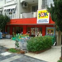 Photo taken at Şok Market Bostanlı Şehitler by tuna t. on 2/11/2013