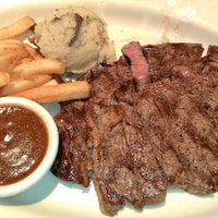 Photo taken at Outback Steakhouse by Reiko M. on 6/24/2014
