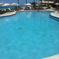 Photo taken at Grand Cayman Marriott Beach Resort by Scott B. on 9/23/2012