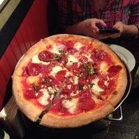 Photo taken at Johnny Rad's Pizzeria Tavern by Emily M. on 3/6/2014