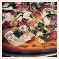 Photo taken at Stromboli Pizza by Sam L. on 10/14/2012