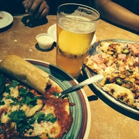 Photo taken at California Pizza Kitchen by Agustin E. on 7/18/2014