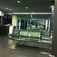Photo taken at Gates B by olga r. on 11/9/2012
