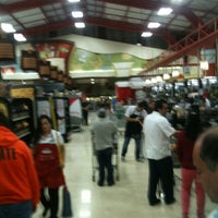 Photo taken at Auto Mercado by Javier D. on 12/31/2012