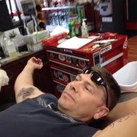 Photo taken at Lucky 13 Tattoo by Kimberly K. on 6/14/2014