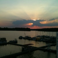 Photo taken at Rick's Cafe Boatyard by Chris S. on 12/21/2012