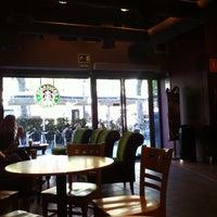 Photo taken at Starbucks Coffee by Tati on 5/3/2013