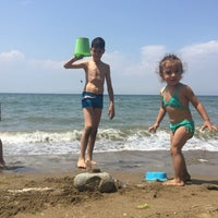 Photo taken at Palmiye Beach by Safiye Ü. on 6/28/2016