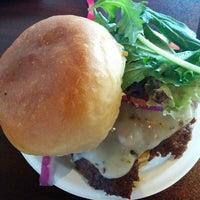 Photo taken at Grind Burger Kitchen by Kela I. on 6/11/2014