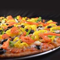 Photo taken at JT's Pizza & Pub by JT's Pizza & Pub on 4/4/2014