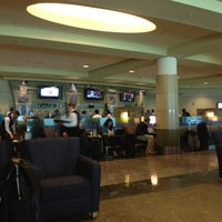 Photo taken at American Airlines Admirals Club by Rachel T. on 5/9/2013