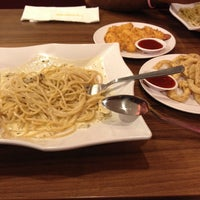 Photo taken at PastaMania by Inna T. on 3/24/2014