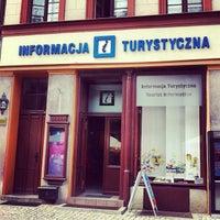 Photo taken at Torun Tourist Information by Jaroslaw M. on 7/19/2013