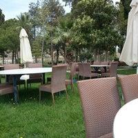 Photo taken at Pamukkale Garden Cafe by Melike I. on 4/11/2014
