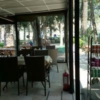 Photo taken at Pamukkale Garden Cafe by Melike I. on 4/15/2014
