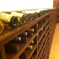 Photo taken at Wine Spot by Clau d. on 3/21/2014