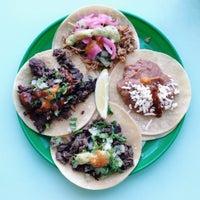 Photo taken at La Taqueria Pinche Taco Shop by Kim R. on 6/4/2014