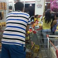 Photo taken at Bom Dia Supermercado by Andreia E. on 5/1/2014