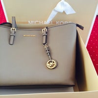 Photo taken at Michael Kors by Jasween K. on 5/21/2015