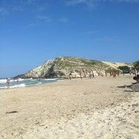 Photo taken at Playa Parguito by Ivan E. on 1/8/2013
