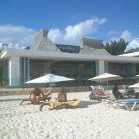 Photo taken at Mamita's Beach Club by Juan G. on 12/17/2012