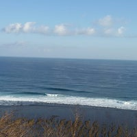 Photo taken at Bali Cliff Beach by Risky A. on 9/10/2014