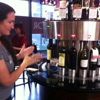 Photo taken at OC Wine Mart & Tasting Bar by Brianna M. on 6/28/2014
