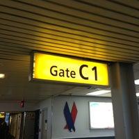 Photo taken at Concourse C by Porfirio P. on 8/4/2013