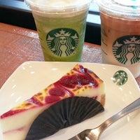 Photo taken at Starbucks by Nur S. on 3/23/2014