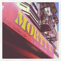 Photo taken at Morty's Delicatessen by Jerome P. on 3/20/2014