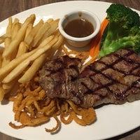 Photo taken at Black Angus Steakhouse by Simon T. on 10/5/2014