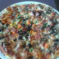 Photo taken at La Cucina by Larissa on 6/7/2014