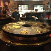 Photo taken at HuHot Mongolian Grill by Ian W. on 6/22/2013