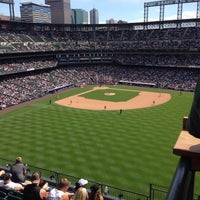 Photo taken at The Rooftop @ Coors Field by Sydney R. on 7/5/2014