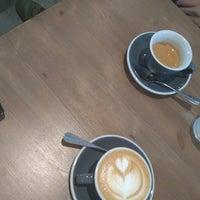 Photo taken at Monks Coffee Roasters by Sasha G. on 6/24/2017