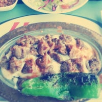 Photo taken at Uğur Mangal by Cansu A. on 12/24/2014