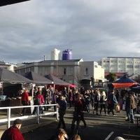 Photo taken at Dunedin Saturday Farmer's Market by Kenn M. on 7/25/2014