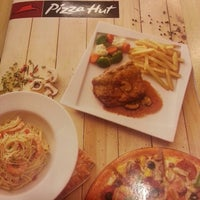 Photo taken at Pizza Hut by Ole R. on 3/10/2013