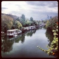 Photo taken at Pont de Levallois by Vincent N. on 10/30/2012