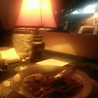 Photo taken at Rooster's Steak & Chop House by Vladimir K. on 9/1/2014