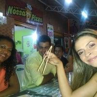 Photo taken at Cantinho Nossa Pizza by Luanna T. on 4/3/2014